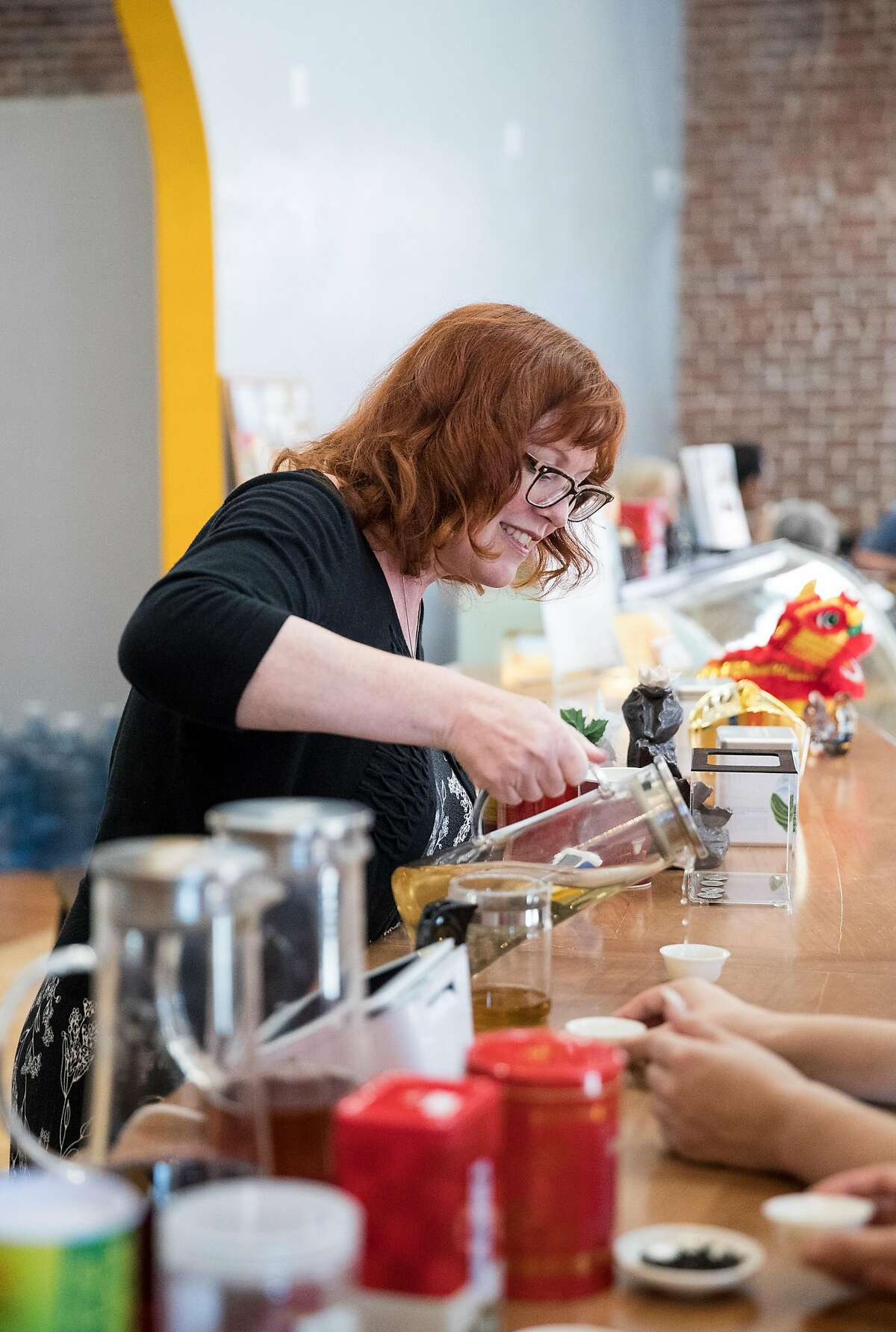 Tea guide Angela DeMoss pours tea for a tea flight tasting at Tea-Tasting in downtown Lodi, Calif., on Saturday, August 17, 2019. The business offers table tastings of a type of Wuyi Rock Tea and also flight tastings of tea.
