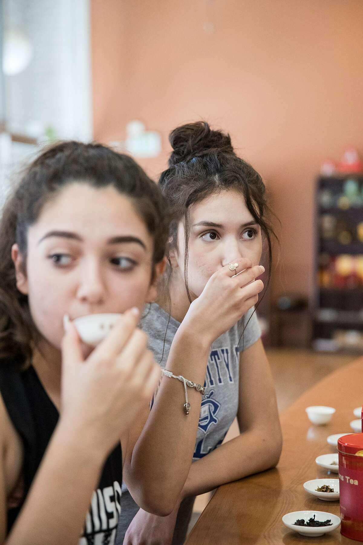 Bianca Torrente (left) and Annette Kaehler participate in a tea flight tasting at Tea-Tasting in downtown Lodi, Calif., on Saturday, August 17, 2019. The business offers table tastings of a type of Wuyi Rock Tea and also flight tastings of tea.