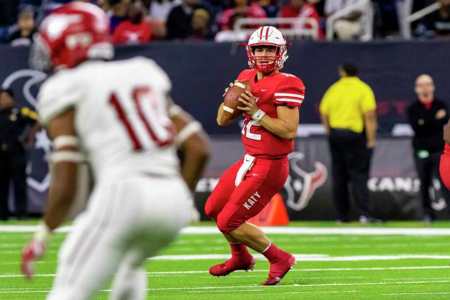 Katy quarterback Bronson McClelland (12) rolls out for a pass in the second half of a Class 6A Div. I Semi-Final high school football playoff game at NRG Stadium on Friday, Nov 30, 2018, in Houston. Photo: Joe Buvid, Houston Chronicle / Contributor / © 2018 Joe Buvid