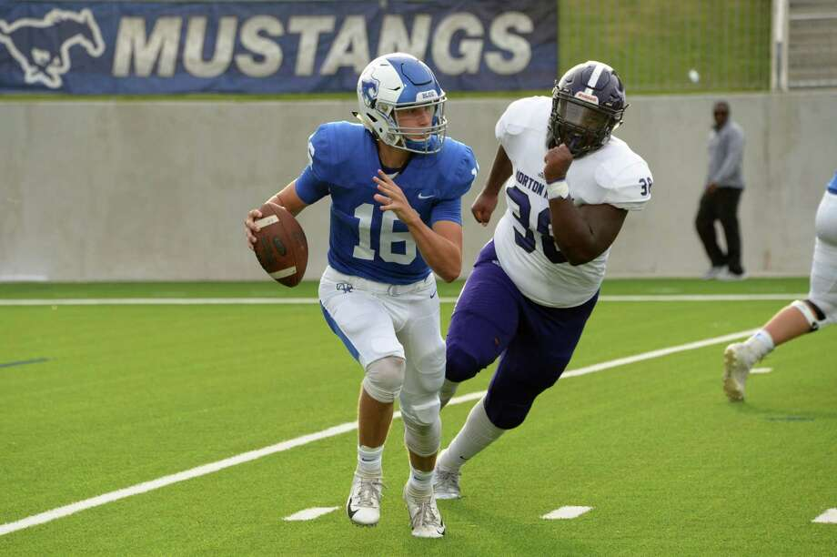 Brandon Brown (38) of Morton Ranch pressures quarterback Dalton Burden (16) of Katy Taylor in the first quarter of a high school football game between the Katy Taylor Mustangs and Morton Ranch Mavericks on Saturday, September 29, 2018 at Legacy Stadium, Katy, TX. Photo: Craig Moseley, Houston Chronicle / Staff Photographer / ©2018 Houston Chronicle
