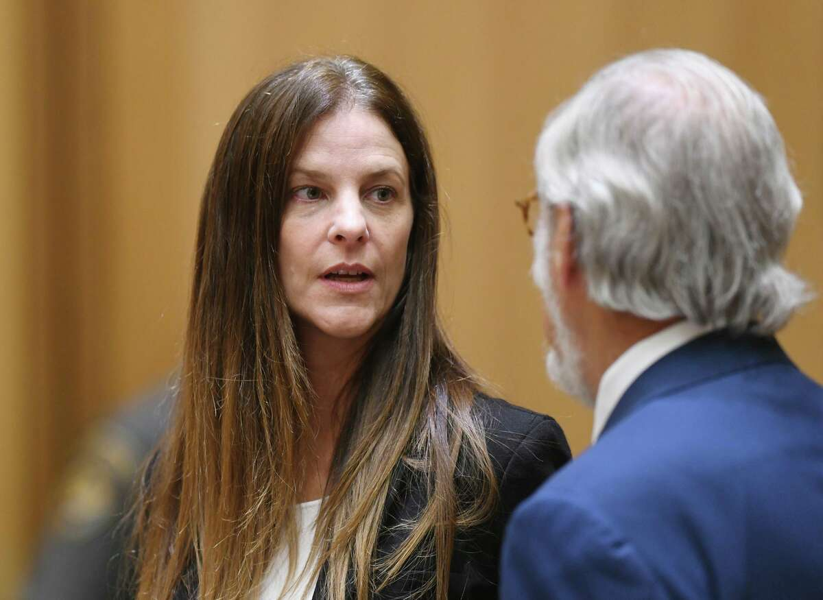Michelle C. Troconis, 44, appears in court with her attorney Andrew Bowman in relation to her charges of tampering with or fabricating physical evidence and first-degree hindering prosecution, to which she has pleaded not guilty, at Connecticut Superior Court in Stamford, Conn. Monday, Aug. 19, 2019.