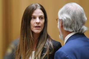Michelle C. Troconis, 44, appears in court with her attorney Andrew Bowman in relation to her charges of tampering with or fabricating physical evidence and first-degree hindering prosecution.