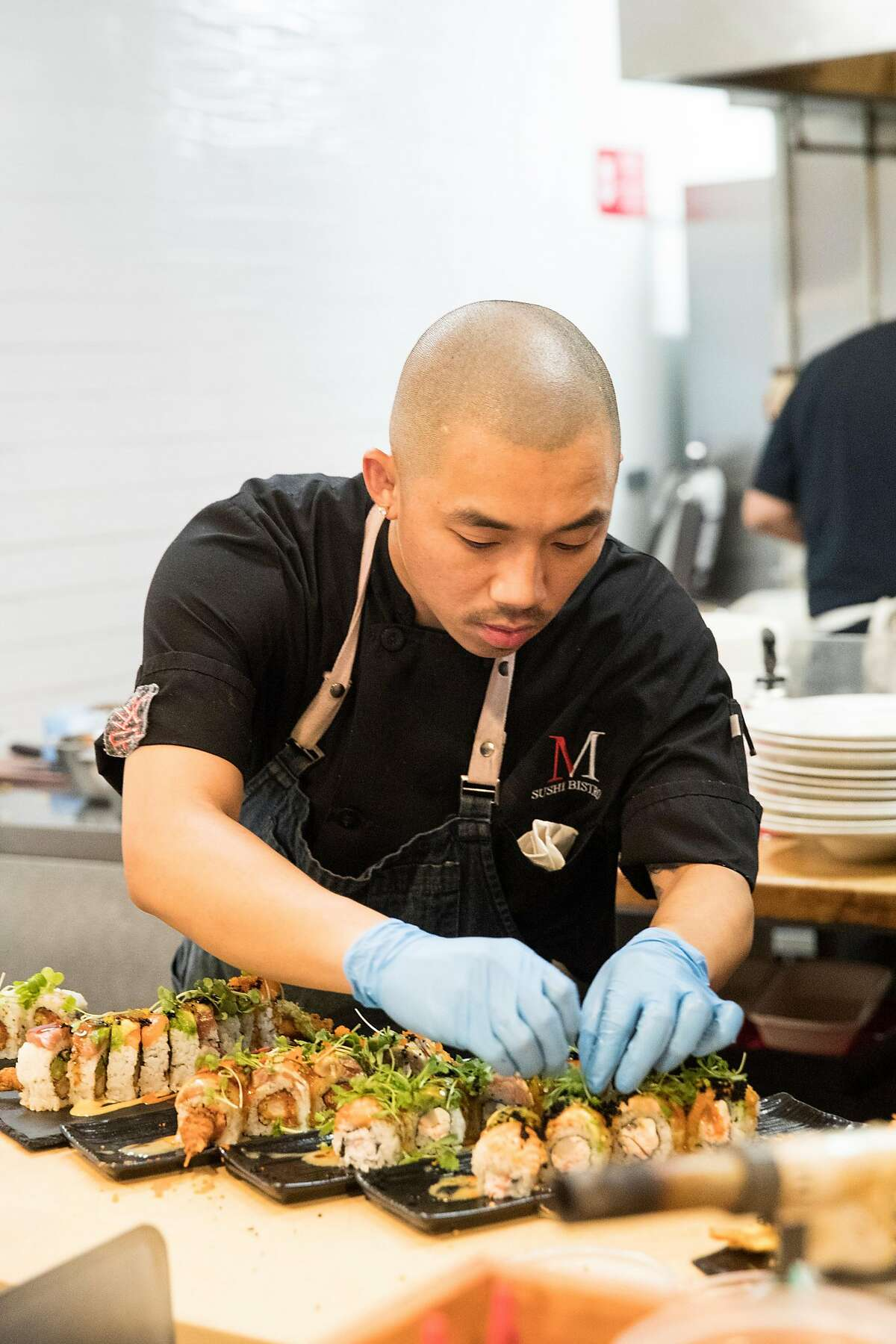 Chef Vu Huynh puts the finishing touches on sushi rolls at M Sushi Bistro in downtown Lodi, Calif., on Thursday, August 15, 2019.