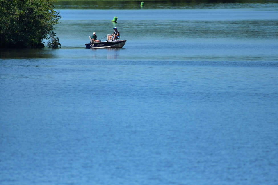 Two people fish on the Mohawk River above the flight of locks on Monday, Aug. 26, 2019, in Waterford, N.Y. (Paul Buckowski/Times Union)