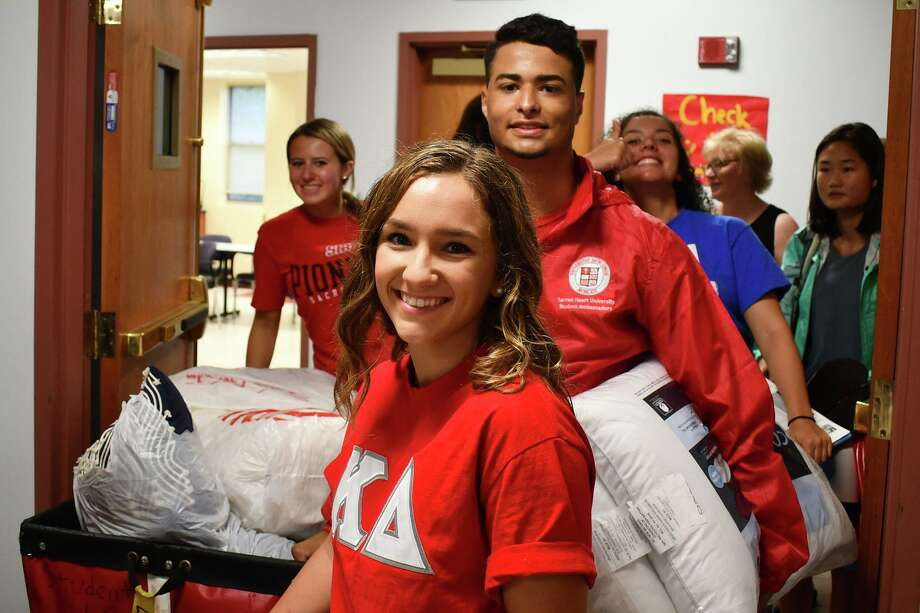 Student arrived on campus and began moving into resident halls at Sacred Heart University, in Fairfield, Conn. Aug. 23, 2019. Classes at Sacred Heart begin Monday. Photo: Vic Eng/For Hearst Connecticut Media / Hearst Connecticut Media / Hearst Connecticut Media