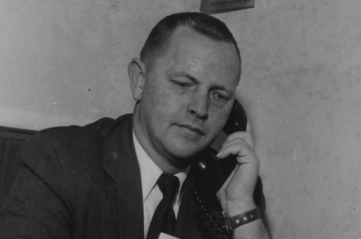 Hoosick Falls, New York Mayor Richard A Severson talks on telephone while looking at papers. February 13, 1973 (Bob Paley/Times Union Archive)