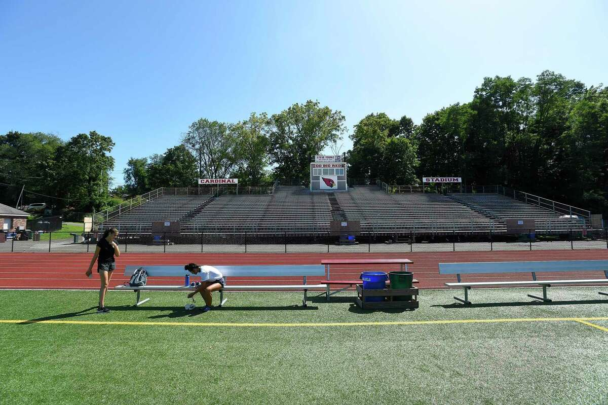 A crew from Veteran's Scaffold and Sevice Inc. out of Blackstone, MA install temporary structural scaffolding support to the bleachers at Greenwich High School's Cardinal Stadium on August 26, 2016.