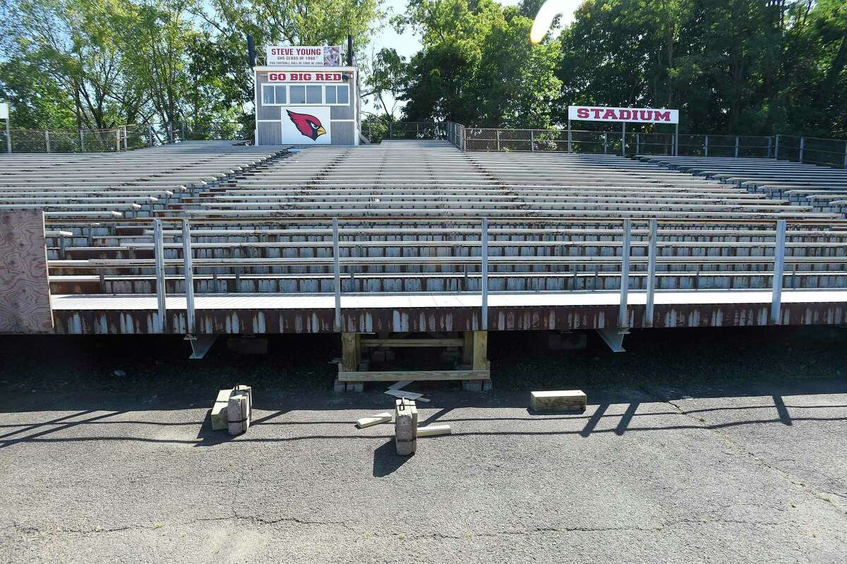 A crew installs temporary structural scaffolding support to the bleachers at Greenwich High School's Cardinal Stadium on Aug. 26, 2016.