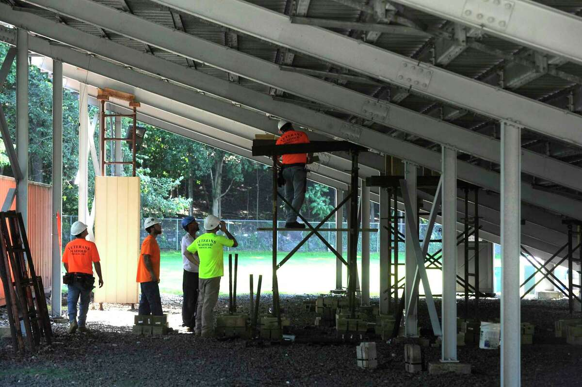 A crew from Veteran's Scaffold and Sevice Inc. out of Blackstone, MA install temporary structural scaffolding support to the bleachers at Greenwich High School's Cardinal Stadium on August 26, 2019.