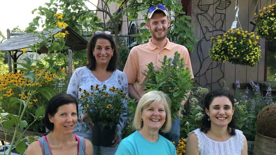 Planet New Canaan, the New Canaan Land Trust and Copia Nursery in Vista, N.Y., are working together to promote the New Canaan Pollinator Pathway. Promoting the plant sale to benefit the pathway, in front, are Lynn Canaan of Planet New Canaan, Catharine Sturgess of the New Canaan Land Trust and Jennifer Cipriano of Copia. In back are Nancy Bemis of the Land Trust and Land Trust Executive Director Aaron Lefland. Photo: Contributed Photo / Planet New Canaan / New Canaan Advertiser Contributed