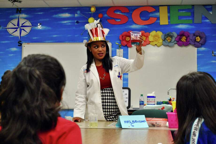 Juliette Broussard, a fifth-grade science teacher at Schneider Middle School in Pasadena ISD, was recently named Region 4's elementary teacher of the year. She often includes science experiments in her classes. Photo: Houston Chronicle Photo By Tyler Johnson