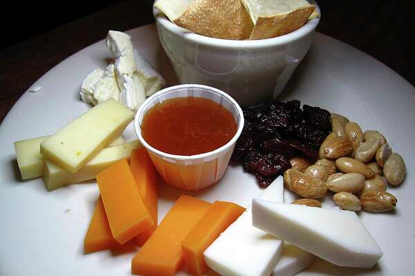 Having guests? Make a cheese plate with almonds, dried cherries, preserves and crackers.