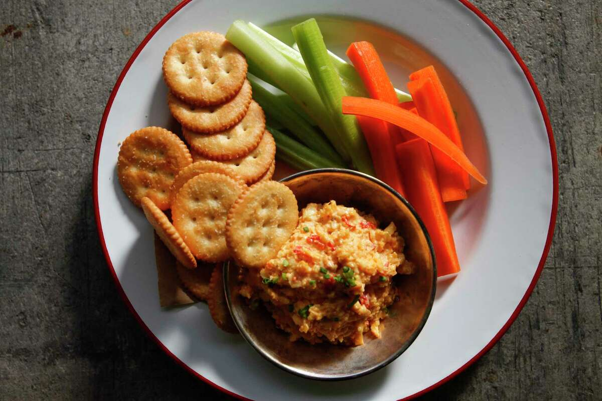 Snack on carrots, celery, cheese and crackers, but limit yourself to 200 calories.