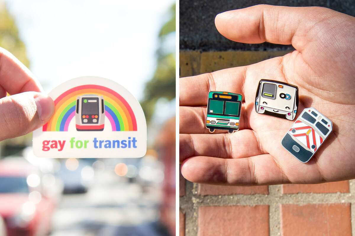 Chris Arvin, a 29-year-old Cole Valley resident, holds up some of his most popular transit merchandise - a Gay For Transit sticker and a trio of pins showcasing AC Transit, BART, and Caltrain.