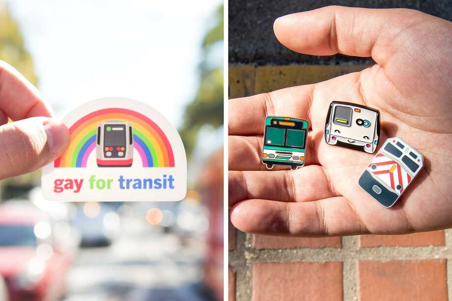 Chris Arvin, a 29-year-old Cole Valley resident, holds up some of his most popular transit merchandise — a Gay For Transit sticker and a trio of pins showcasing AC Transit, BART, and Caltrain. Photo: Blair Heagerty / SFGate