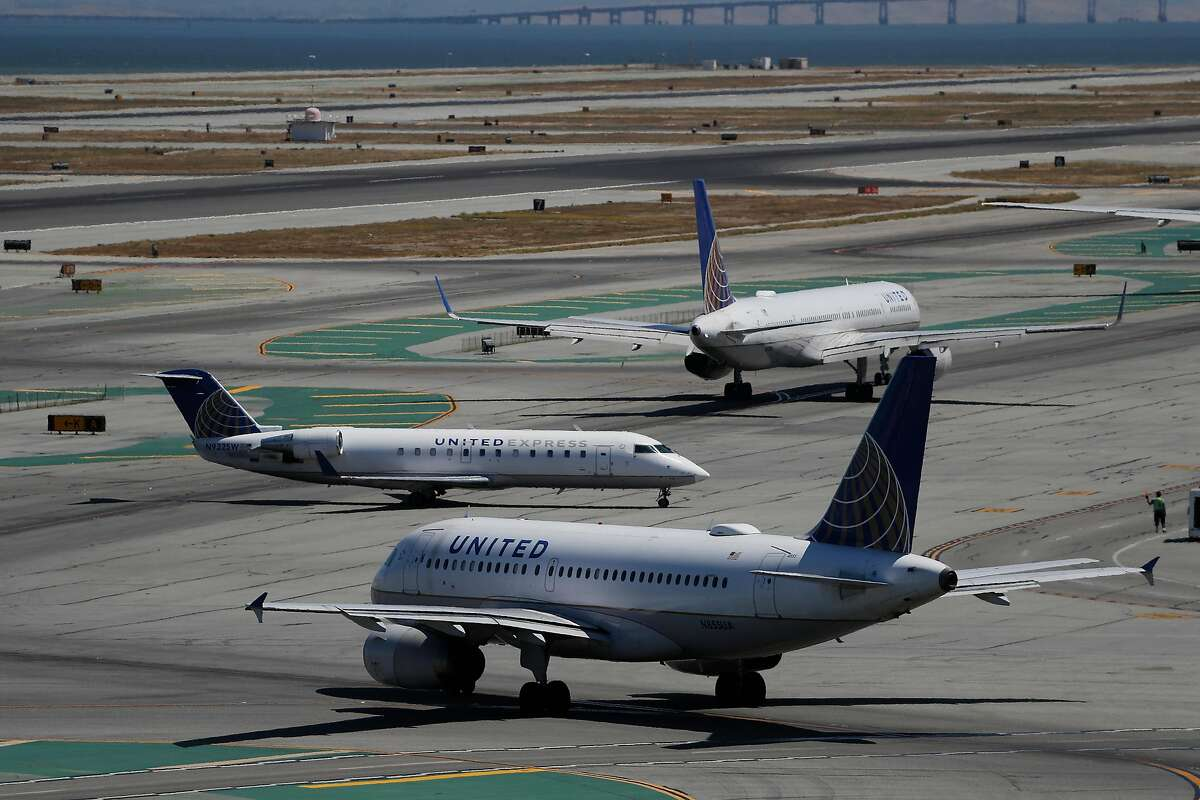 United Airlines aircrafts taxi along runway 28L at San Francisco International Airport in San Francisco, Calif. on Monday, August 26, 2019