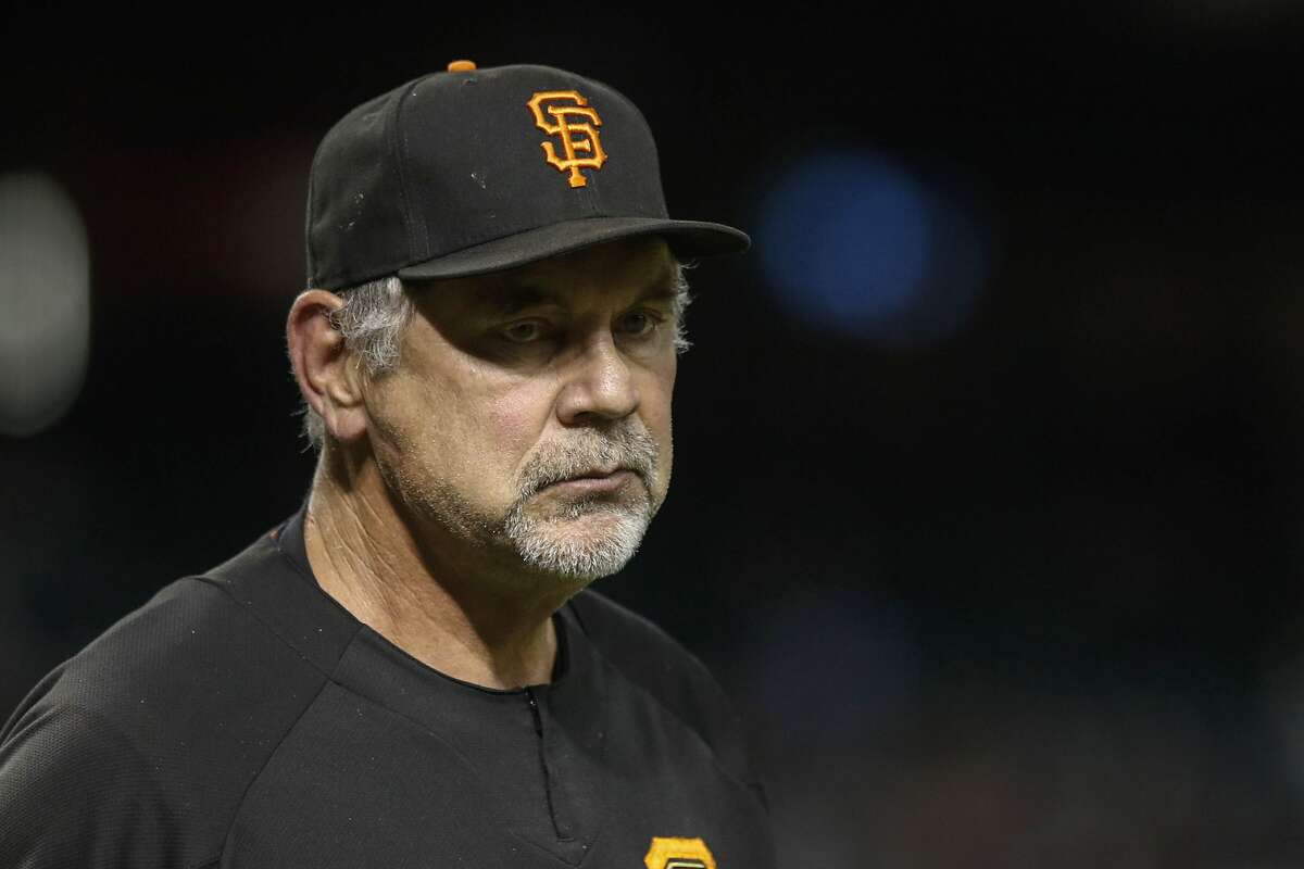 San Francisco Giants manager Bruce Bochy walks back to the dugout as his team play the Arizona Diamondbacks during the eighth inning of a baseball game Thursday, Aug. 15, 2019, in Phoenix. (AP Photo/Darryl Webb)