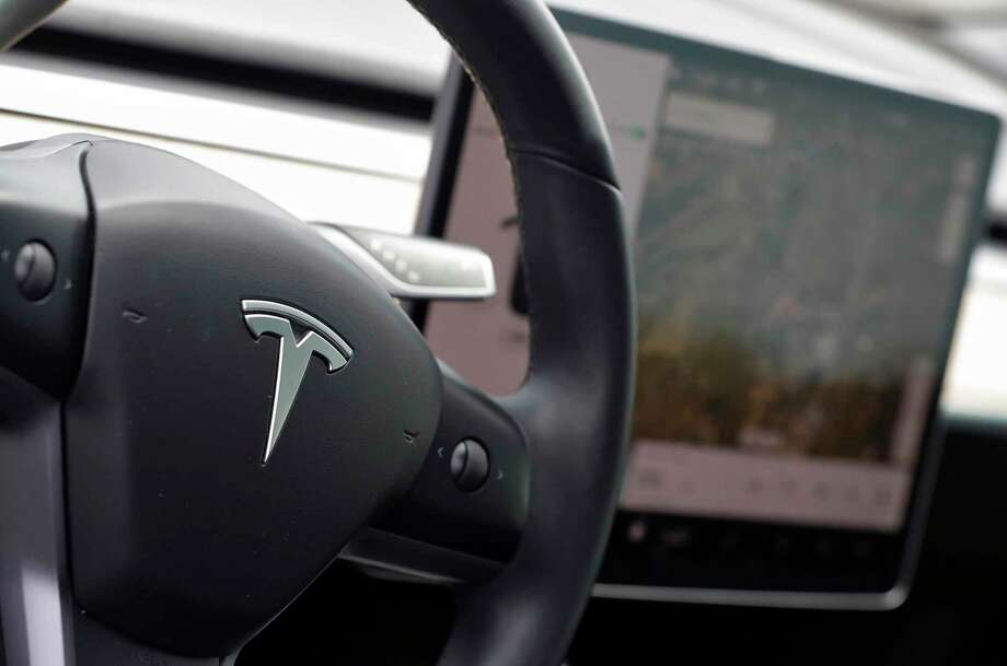 The interior of a Tesla Model 3 Photo: Matt York / Associated Press / Copyright 2019 The Associated Press. All rights reserved.