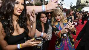 Taylor Swift, right, takes a selfie with a fan as she arrives at the MTV Video Music Awards at the Prudential Center on Monday, Aug. 26, 2019, in Newark, N.J. (Photo by Charles Sykes/Invision/AP)