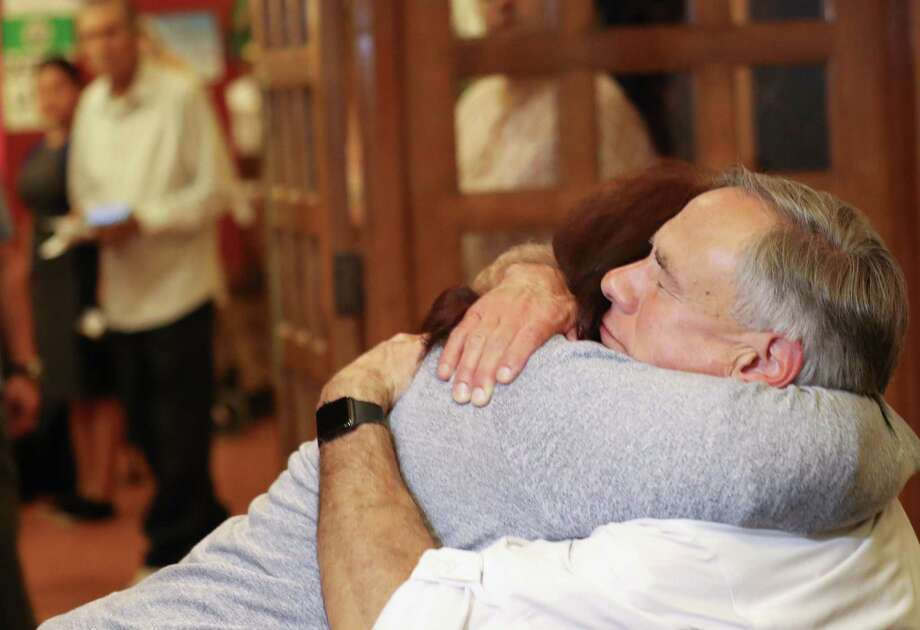 Gov. Greg Abbott hugs a woman following a vigil for the victims of the El Paso mass shooting. A reader points out the governor hasn't taken action against gun violence. Photo: Mario Tama / Getty Images / 2019 Getty Images