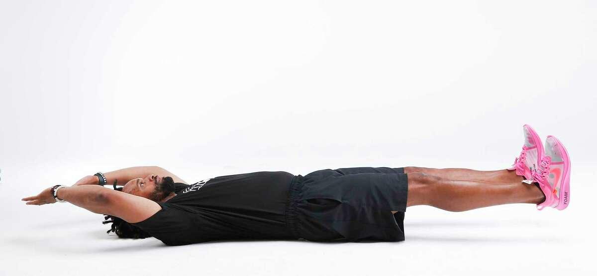 Fit City trainer Leo Johnson demonstrates V Ups. Step 1.