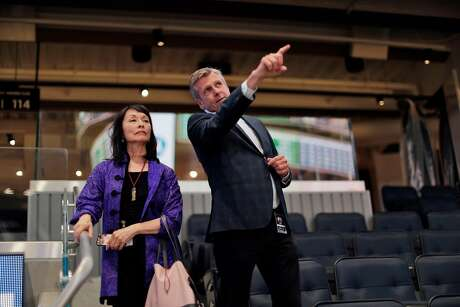Feng Shui practitioner Deborah Gee takes a tour of the new Chase Center arena with Warriors President and Chief Operating Officer Rick Welts in San Francisco, Calif., on Tuesday, August 13, 2019. Gee has evaluated several new sports venues in the Bay Area for San Francisco columnist Scott Ostler in the past, and gave her observations of the Warriors new home. Photo: Carlos Avila Gonzalez / The Chronicle