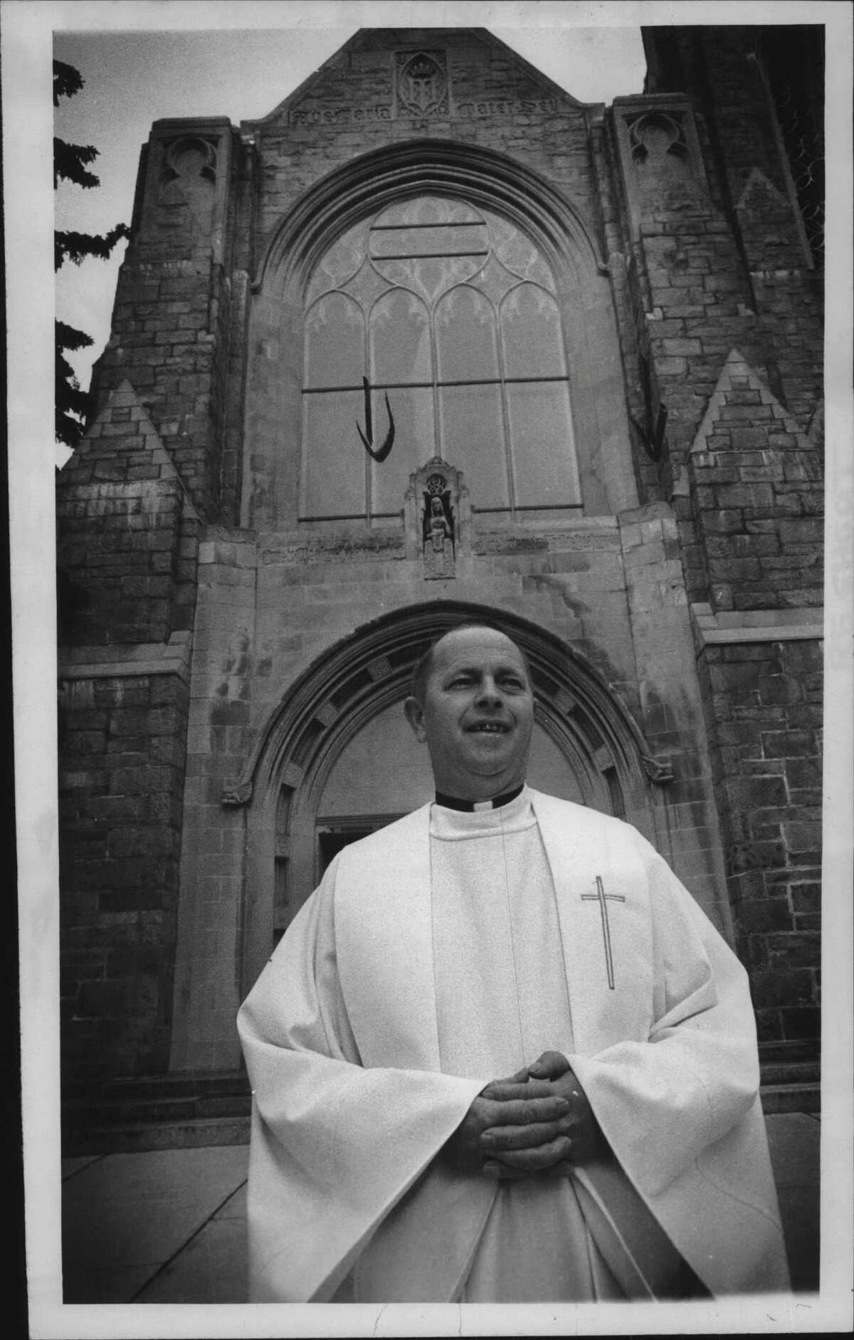 Reverend Richard Severson stands outside Immaculate Heart of Mary Church, Hudson Falls, NewYork. November 25, 1982 (Bob Richey/Times Union Archive)