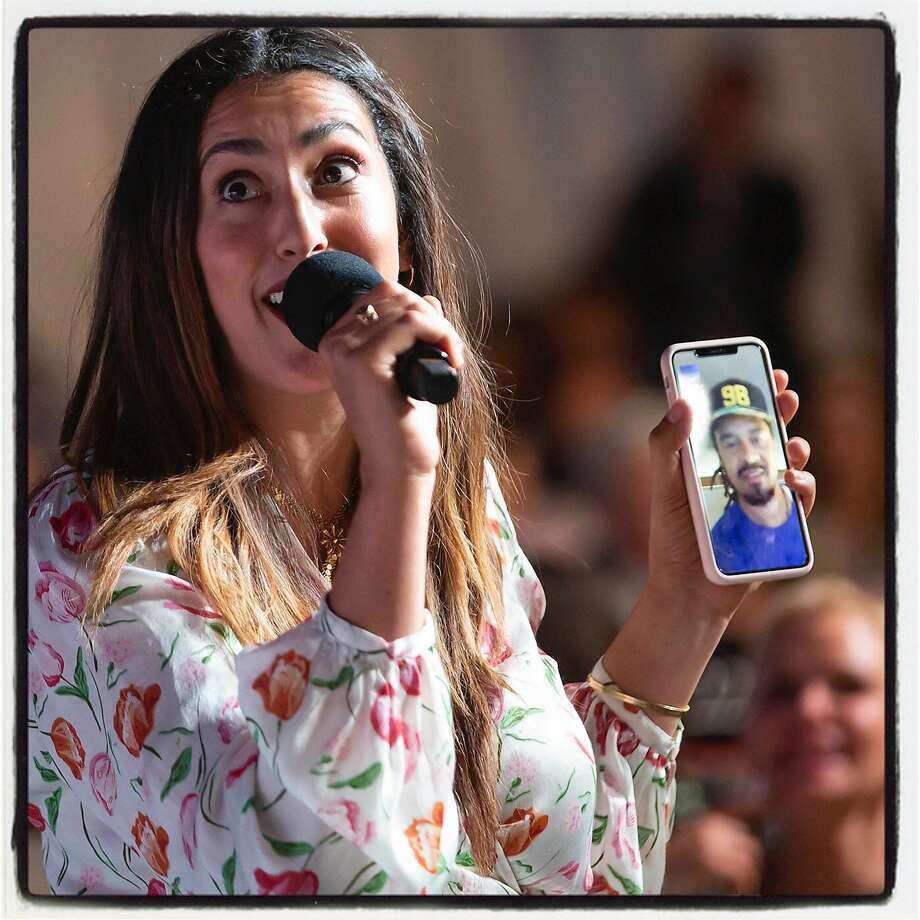 Sara Franti FaceTimes husband Michael Franti at the V Foundation fete. August 2019. Photo: Courtesy V Foundation