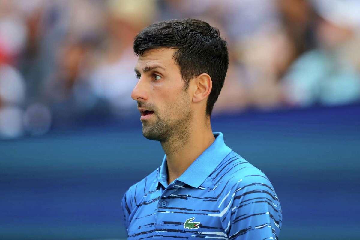 NEW YORK, NEW YORK - AUGUST 26: Novak Djokovic of Serbia reacts during his Men's Singles first round match against Roberto Carballes Baena of Spain during day one of the 2019 US Open at the USTA Billie Jean King National Tennis Center on August 26, 2019 in the Flushing neighborhood of the Queens borough of New York City. (Photo by Elsa/Getty Images)