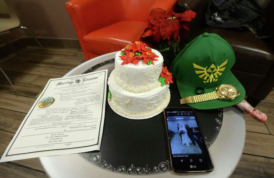 This Friday, Aug. 23, 2019, photo, shows the wedding cake, marriage license and other personal items on a table as friends and family gather to cut the wedding cake and support one another at a donut shop in Vidor, Texas, where Harley Morgan worked as a night baker. Harley Joe Morgan and his bride, Rhiannon Marie Boudreaux, had just been married at the Orange County Justice of the Peace and were pulling onto a highway when they were fatally struck by a truck. (Kim Brent/The Beaumont Enterprise via AP) Photo: Kim Brent, MBI / Associated Press / The Beaumont Enterprise