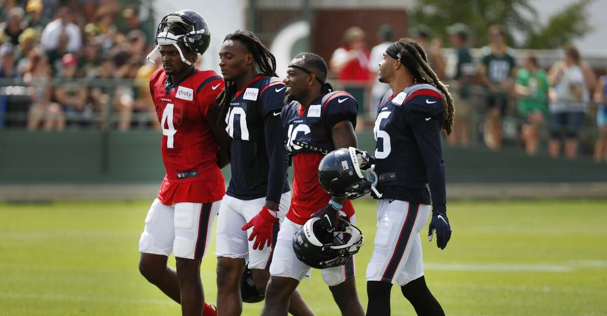 Houston Texans quarterback Deshaun Watson (4) walks with wide receivers DeAndre Hopkins (10), Keke Coutee (16) and Will Fuller (15) during a joint training camp practice with the Green Bay Packers on Monday, Aug. 5, 2019, in Green Bay, Wis.