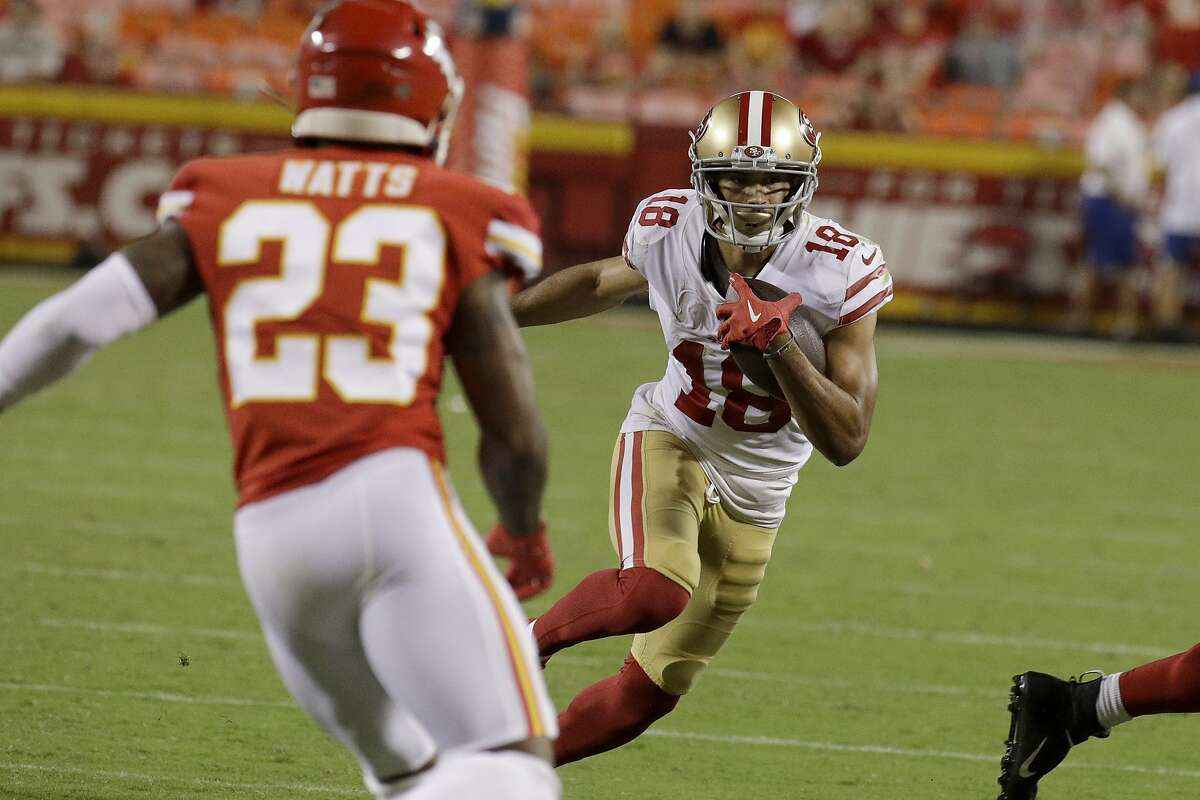 San Francisco 49ers wide receiver Dante Pettis (18) carries the ball during the second half of an NFL preseason football game against the Kansas City Chiefs in Kansas City, Mo., Saturday, Aug. 24, 2019. (AP Photo/Charlie Riedel)