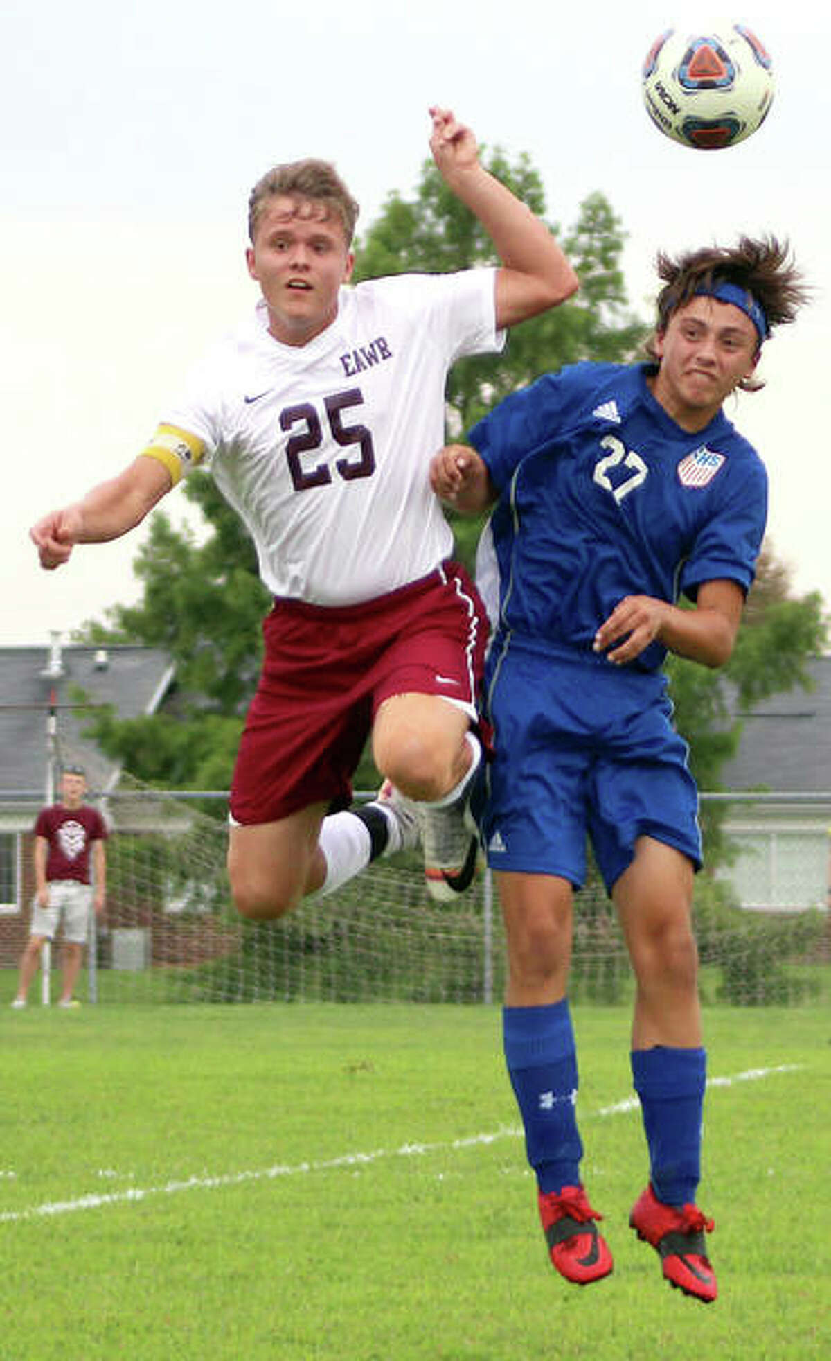 Christian Johnson of EA-WR (25) and Carlinville's Zaiden Reese go high in a battle to head the ball Monday in the season opener at Loveless Park in Carlinville. Johnson had four assists in EA-WR's 7-2 victory.