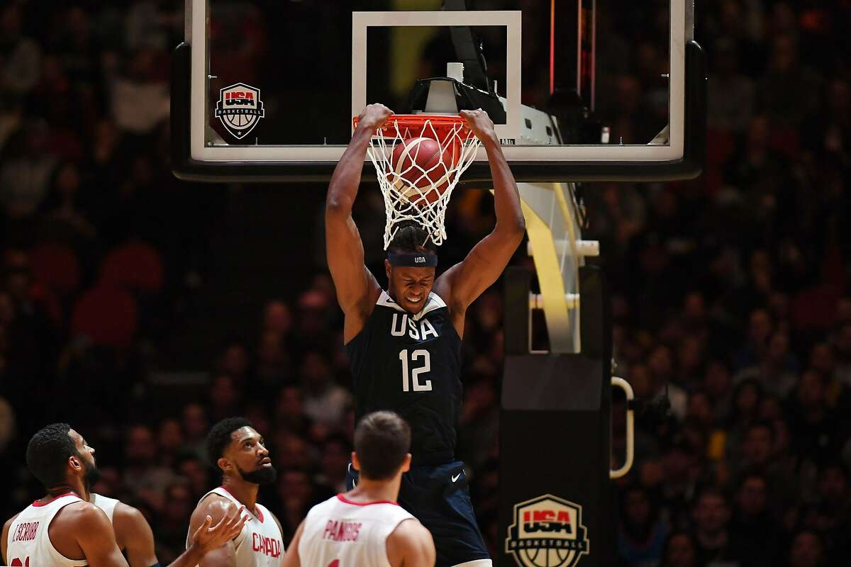 Myles Turner (C) of the US shoots at the basket against Canada during their friendly basketball match in Sydney on August 26, 2019, ahead of the World Basketball Championships in China starting on August 31. (Photo by SAEED KHAN / AFP) / -- IMAGE RESTRICTED TO EDITORIAL USE - STRICTLY NO COMMERCIAL USE --SAEED KHAN/AFP/Getty Images