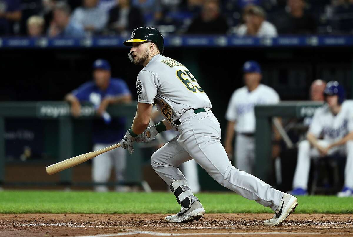 KANSAS CITY, MISSOURI - AUGUST 26: Seth Brown #65 of the Oakland Athletics hits his second hit in his Major League debut during the 3rd inning of the game against the Kansas City Royals at Kauffman Stadium on August 26, 2019 in Kansas City, Missouri. (Photo by Jamie Squire/Getty Images)