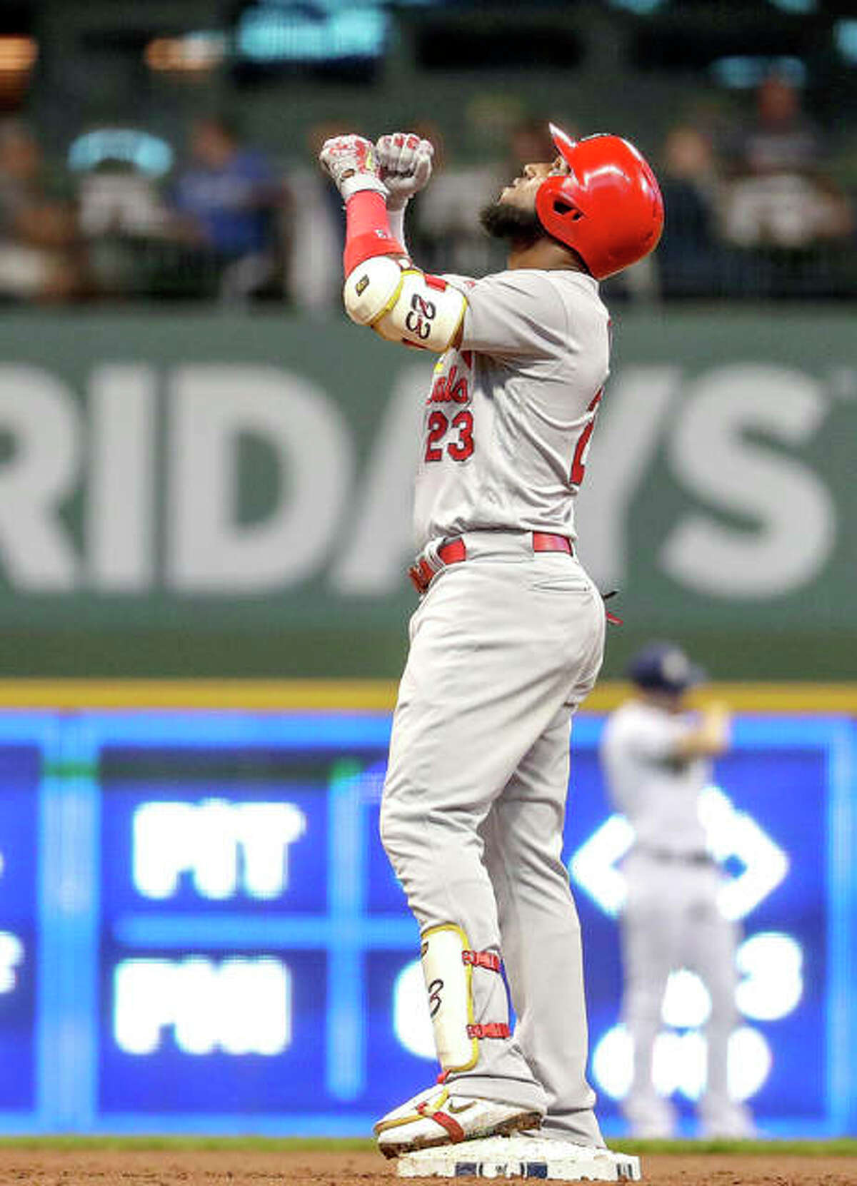 The Cardinals' Marcell Ozuna reacts after hitting a three-run scoring double in the second inning Monday night's game against the Brewers in Milwaukee.