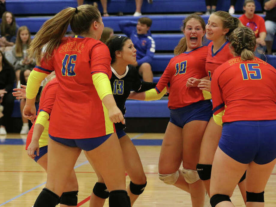 Shells (from left) Kaylen Dixon, Jacey Trask (16), Makenzie Keller (13), Darcey McGuire (10), Macie Lucas and Abbigail Zangori (10) celebrate Lucas' kill in their victory over Gillespie on Monday in the Roxana Tournament. Photo: Greg Shashack / The Telegraph