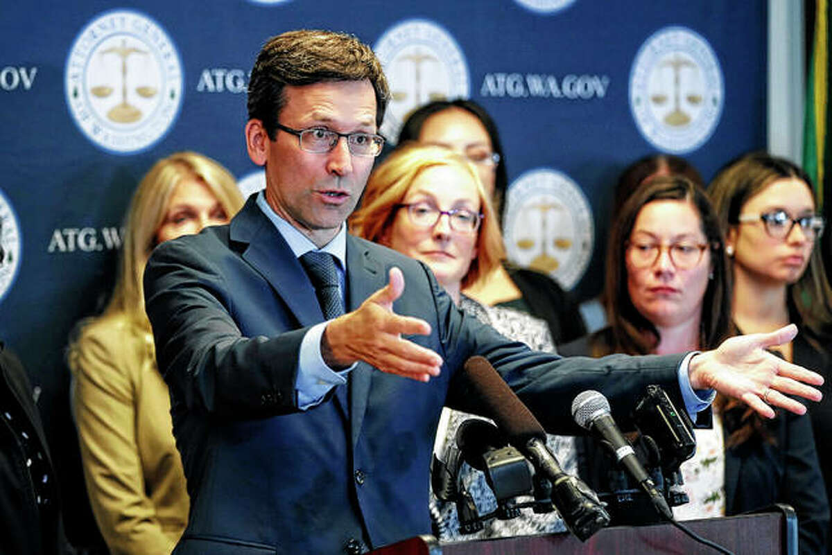 Washington Attorney General Bob Ferguson talks to reporters Monday during a news conference in Seattle.