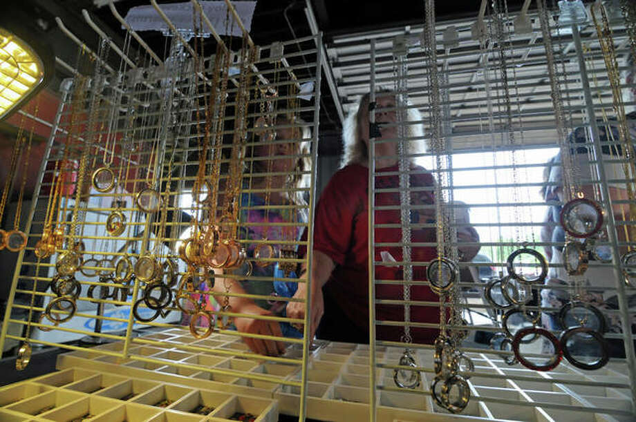 Customers look over one of the displays at Riverside Flea Market in Grafton. Photo: David Blanchette | Hearst Illinois