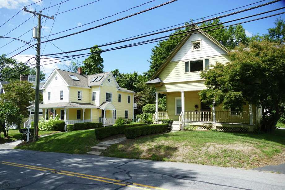 A request will go before the Planning & Zoning Commission for four houses to be built where these two homes are standing at 19 and 25 Richmond Hill Road in New Canaan. The picture was taken August, 26, 2019. Photo: Grace Duffield / Hearst Connecticut Media