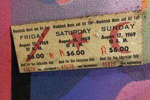 Julie Lomoe saved an uncollected ticket from Woodstock and used it in a collage painting.