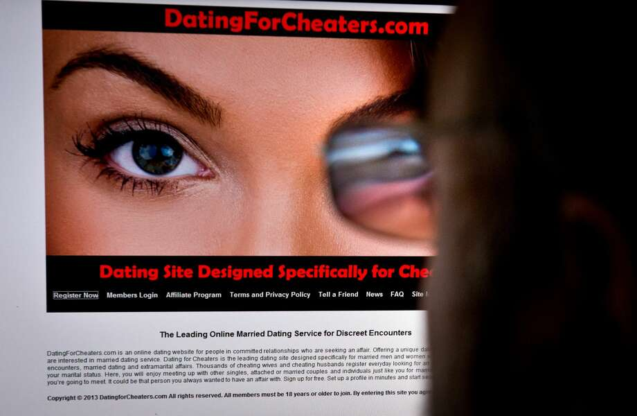 The Guadalupe County Sheriff's office is warning people of scam targeting those who use dating websites. In this illustration, a man looks at a dating site on his computer. A 29-year-old woman says it helped her take revenge on her unfaithful husband. A 45-year-old married man says it has helped prevent the break-up of his family. Photo: EVA HAMBACH/AFP/Getty Images