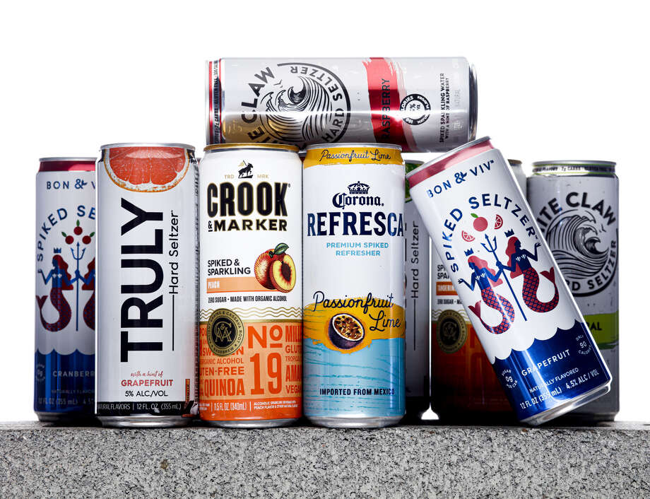 Cans of hard seltzer from Truly, Crook and Marker, Corona Refresca, Bon and Viv, and White Claw are seen on Tuesday, Aug. 13, 2019 in San Francisco, Calif. Hard seltzers were the drink trend of 2019. Photo: Russell Yip / San Francisco Chronicle
