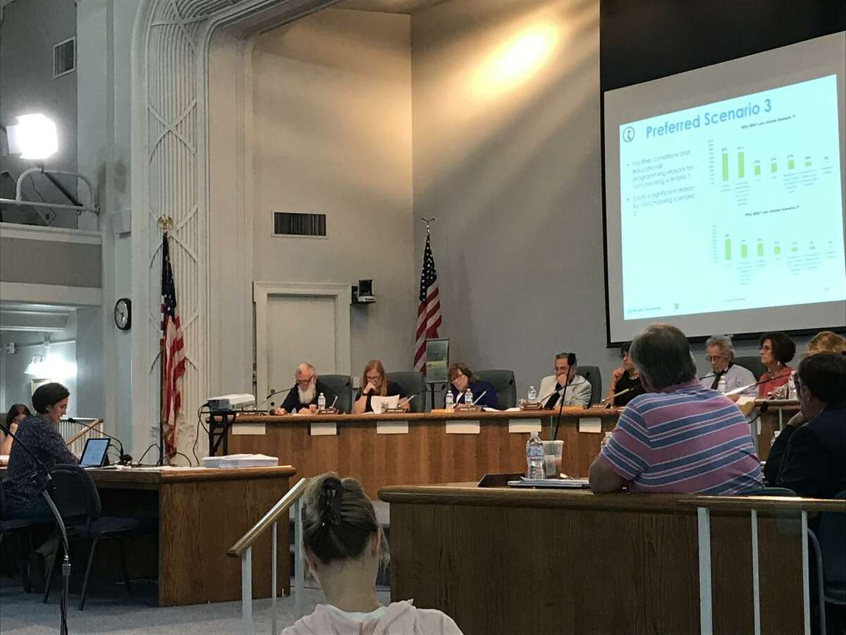 Rebecca Augur, a principal partner in the Cheshire-based Milone & MacBroom consulting firm, presents the results of a survey about Wallingford's school buildings to Board of Education members Monday night at Town Hall.