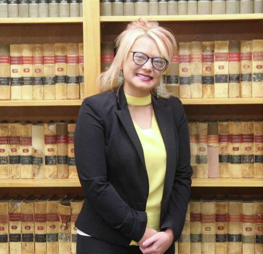 Huron County's court recorder and deputy administrator, Sarah McNames, poses in her office inside the Huron County Building. In her position, McNames is responsible for the official reproduction of courtroom proceedings when a request is filed. (Eric Rutter/Huron Daily Tribune)