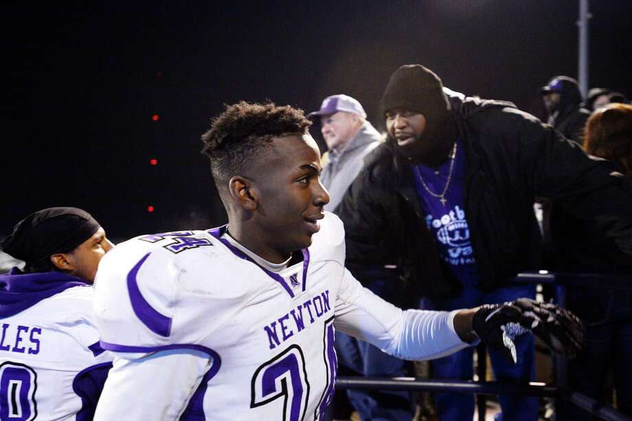 Newton's James Sylvester greets fans after winning the Class 3A Division II regional final against Waskom at Abe Martin Stadium in Lufkin on Friday night.  Photo taken Friday 12/8/17 Ryan Pelham/The Enterprise Photo: Ryan Pelham / Ryan Pelham/Ryan Pelham/The Enterprise / ©2017 The Beaumont Enterprise/Ryan Pelham