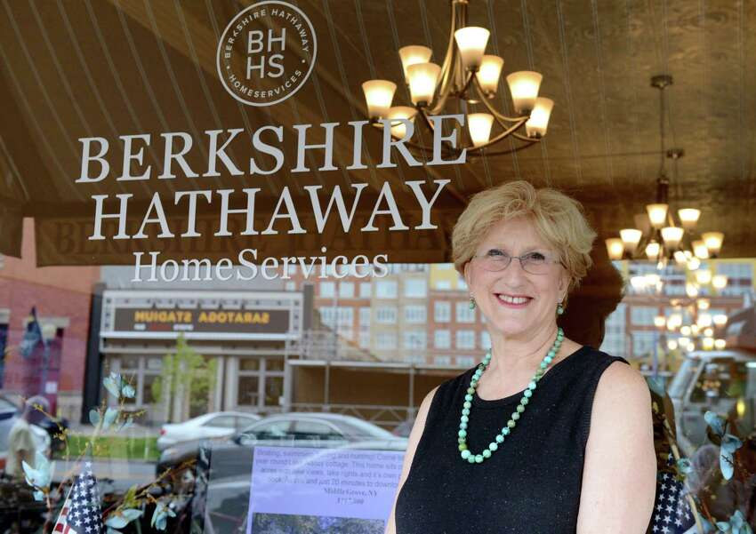 Joan Taub poses for a portrait outside Berkshire Hathaway HomeServices on Tuesday, July 16, 2019, in Saratoga Springs, N.Y. (Catherine Rafferty/Times Union)