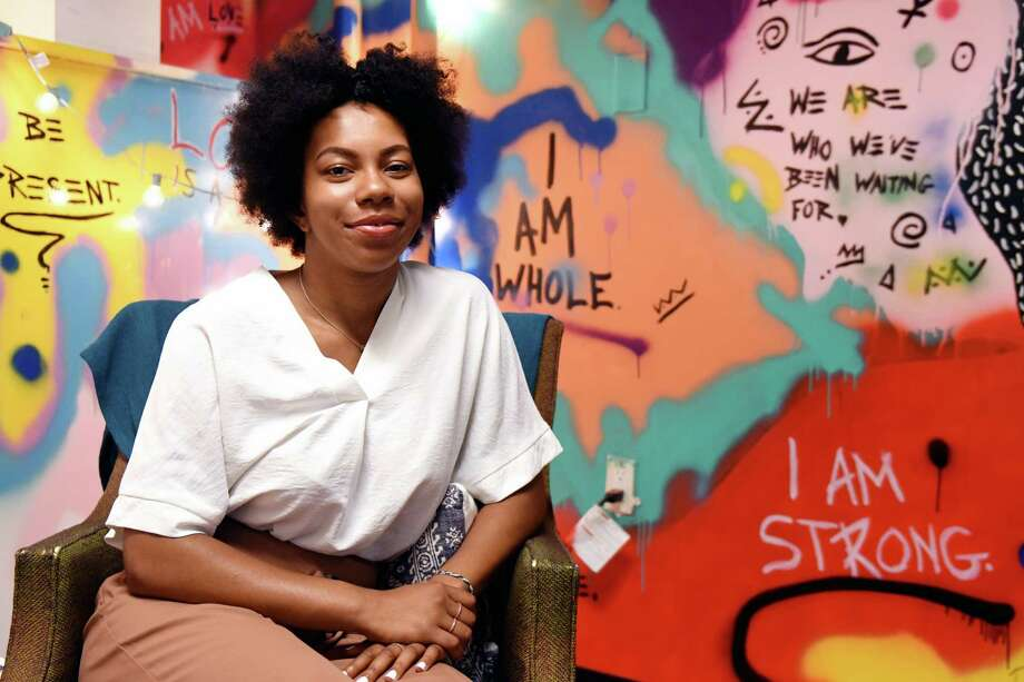Ashley Whiteside, 23, is a young woman up and coming in her social work career, poses for a portrait at Root3d, a yoga/wellness studio, where she conducts group therapy sessions on Monday, July 12, 2019, in Albany, N.Y. (Catherine Rafferty/Times Union) Photo: Catherine Rafferty / 40047459A