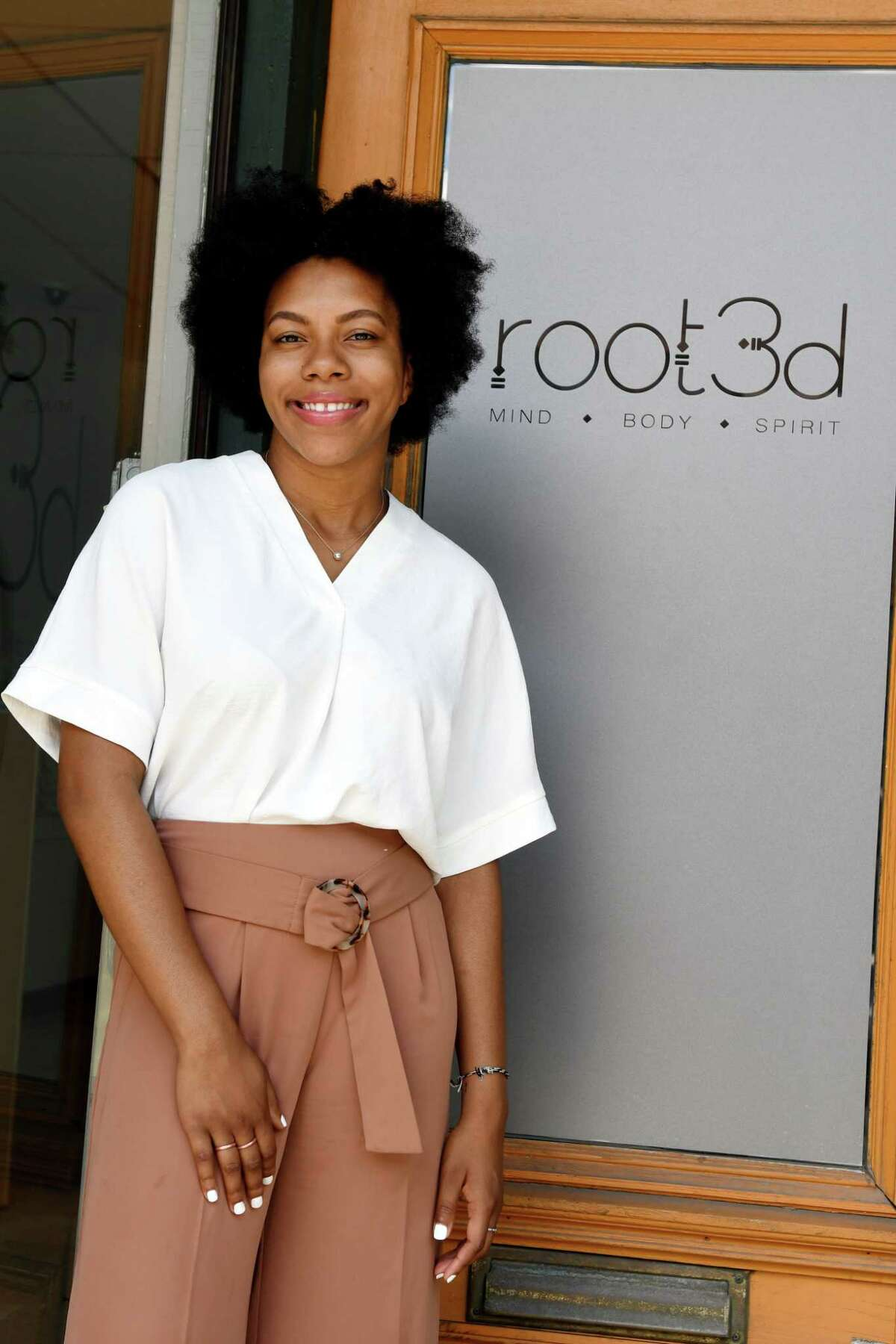 Ashley Whiteside, 23, is a young woman up and coming in her social work career, poses for a portrait at Root3d, a yoga/wellness studio, where she conducts group therapy sessions on Monday, July 12, 2019, in Albany, N.Y. (Catherine Rafferty/Times Union)