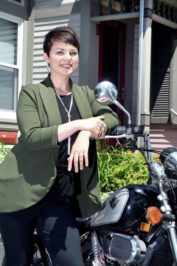 Hannah Stenzel, of Godfrey Financial Associates, poses for a portrait on Wednesday, July 24, 2019, in Glenmont, N.Y. (Catherine Rafferty/Times Union) Photo: Catherine Rafferty / 40047474A
